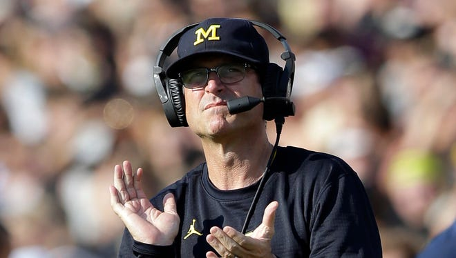 Michigan coach Jim Harbaugh claps after a touchdown against Purdue in the first half of the Wolverines' 28-10 victory in West Lafayette, Ind., Saturday, Sept. 23, 2017.