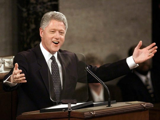 FILE - In this Jan. 19, 1999, file photo, President Bill Clinton gestures while giving his State of the Union address on Capitol Hill in Washington. President Donald Trump will deliver his State of the Union address at one of the most contentious times in his stewardship of the nation, but others may have had it worse: Abraham Lincoln had the Civil War, Richard Nixon was caught up in Watergate and Clinton was impeached. (AP Photo/J.Scott Applewhite, File)