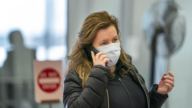 Eileen Hayes of Boston, said she always wears a medical mask when she flies and is not overly concerned about getting the coronavirus after arriving at Palm Beach International Airport in West Palm Beach, Florida on March 2, 2020.