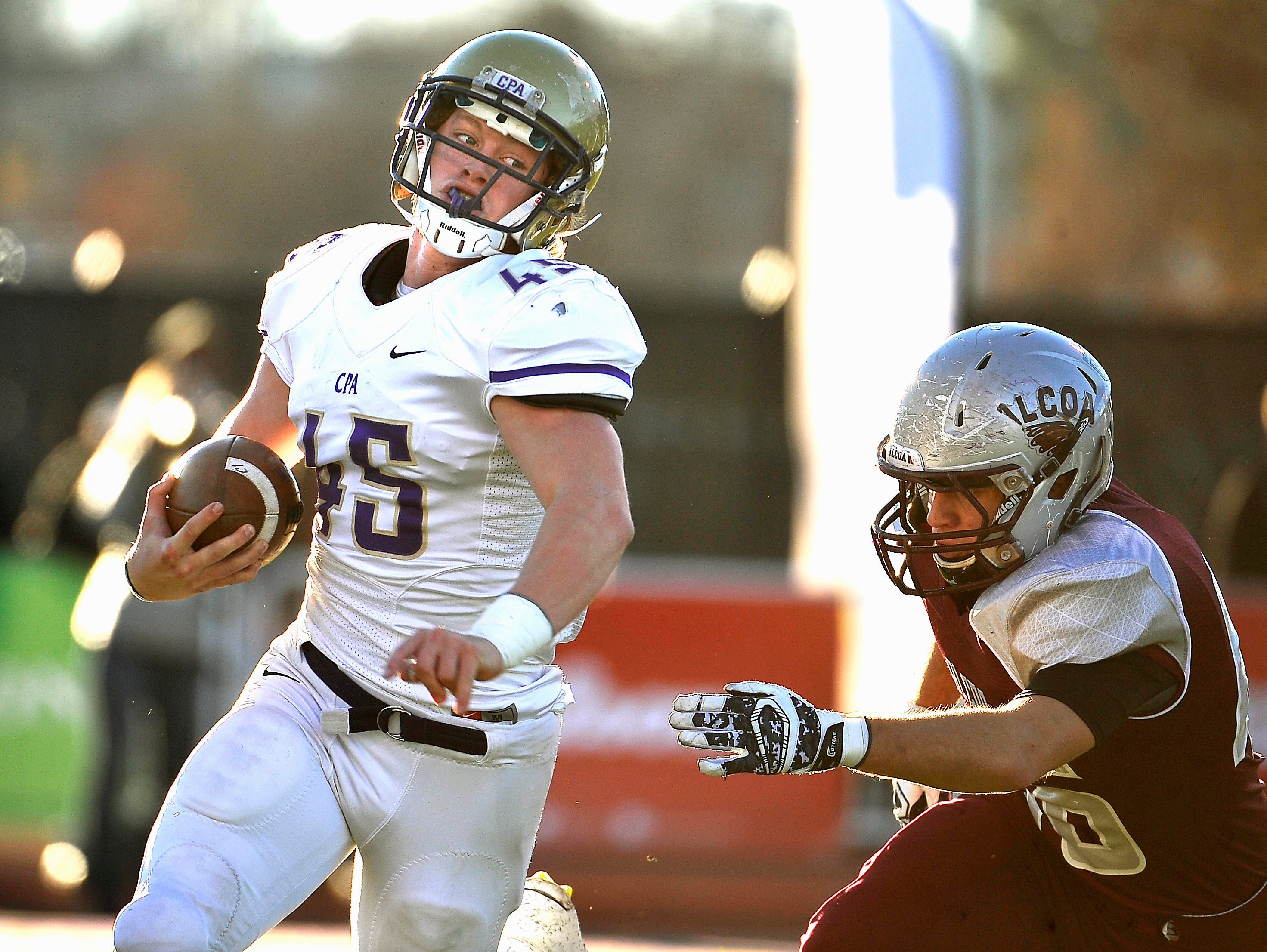CPA's Chip Omer (45) makes the turn around the end against Alcoa in Friday's 3A BlueCross Bowl state title game.