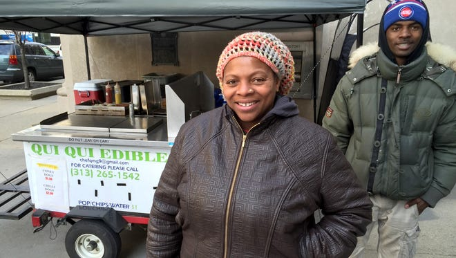 Qui'vonta Job, 43, of Detroit operates a hot dog stand, even during the cold of December, on Fort Street at Washington Boulevard in downtown Detroit on Wed., Nov. 9, 2015.