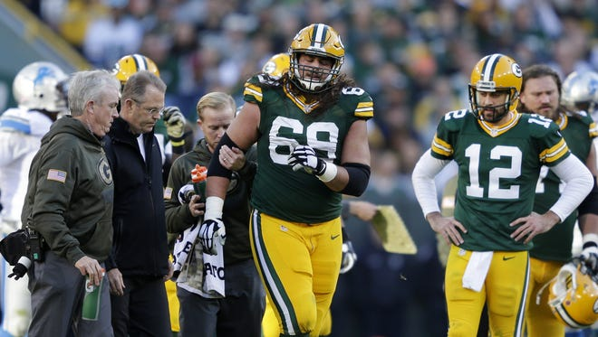 Green Bay Packers' Aaron Rodgers looks on as David Bakhtiari is helped off the field following a fourth quarter injury  The Green Bay Packers host the Detroit Lions at Lambeau Field on Sunday, November 15, 2015, in Green Bay. Wis.  Wm.Glasheen/P-C Media