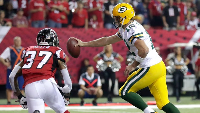 Green Bay Packers quarterback Aaron Rodgers (12)  cross the goal line on a two-point conversion in the fourth quarter against the Atlanta Falcons at the Georgia Dome.