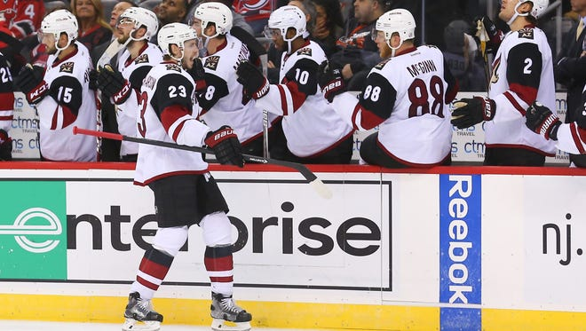 Arizona Coyotes defenseman Oliver Ekman-Larsson (23) celebrates his goal against the New Jersey Devils during the third period at Prudential Center. The Devils defeated the Coyotes 5-3, Oct 25, 2016.