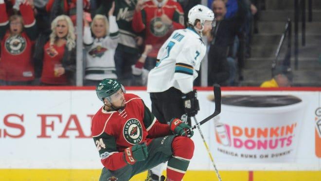 Minnesota Wild defenseman Matt Dumba (24) celebrates his goal against the San Jose Sharks during the first period.