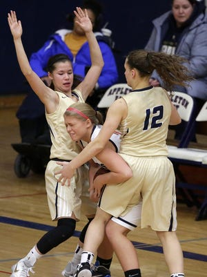 Tricia Dailey of Appleton East is trapped by Kari Brekke and Callie Pohlman (12) of Appleton North during Tuesday's game at East.