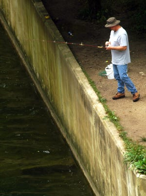 A man fishes the waters of Brookville Lake.