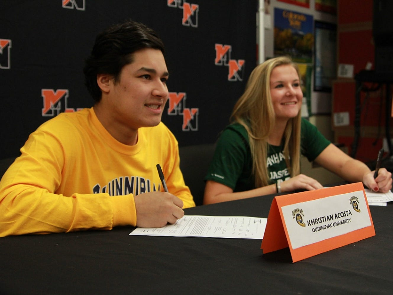 Khristian Acosta (L) and Christine Gebhardt (R) sign National Letters of Intent at Middletown North.