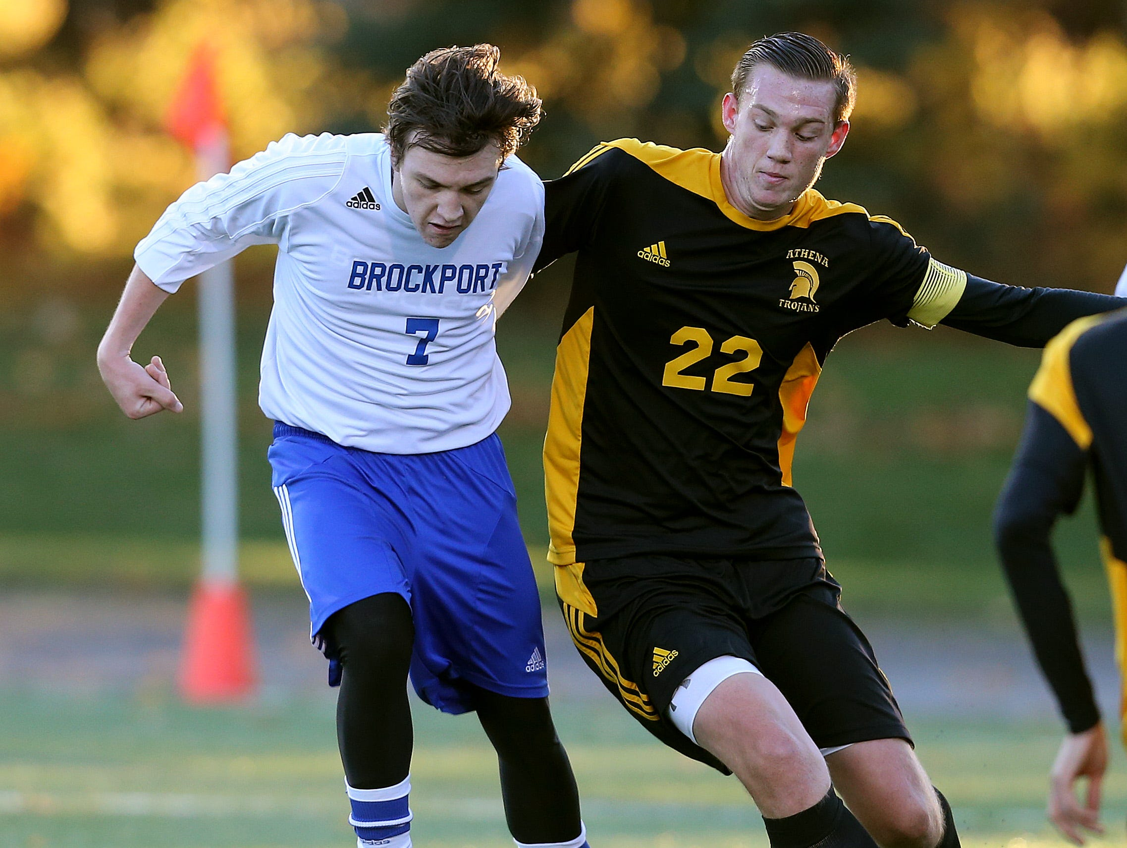 Athena's Zach Koons (22) and Nolan Maines (7) fight for aloes ball.