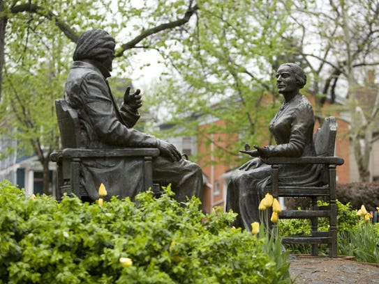 """""""Let's Have Tea"""" sculpture of Susan B. Anthony and Frederick Douglass was created by artist Pepsy Kettavong of Rochester."""