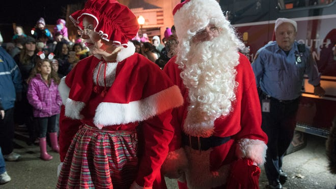 Santa and Mrs. Claus warily scan the crowd, looking out for frenzied kids who might be a bit too excited.