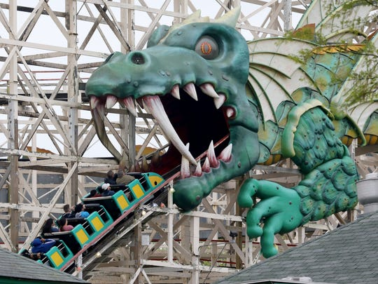 Riders enter the dragon's mouth on the Dragon Coaster ride during the opening day festivities at Playland in Rye, May 12, 2018.
