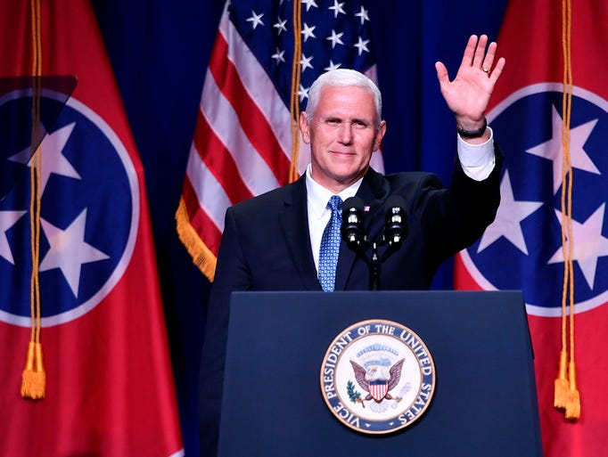 Vice President Mike Pence waves to the crowd during