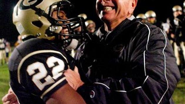 Galesburg High School football coach Tim Dougherty celebrates with runningback Travon Diggins after the Silver Streaks beat Quincy 28-27 in double overtime in 2012. The win earned Galesburg its first playoff spot in 10 years.