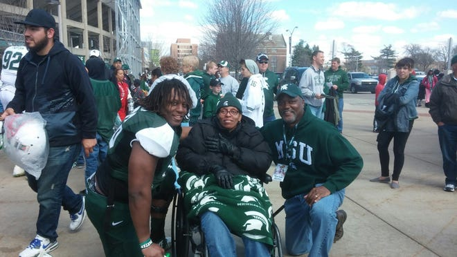 Donavon Clark, left, with mom Jacque', who struggles with multiple sclerosis, and dad Phil Clark.