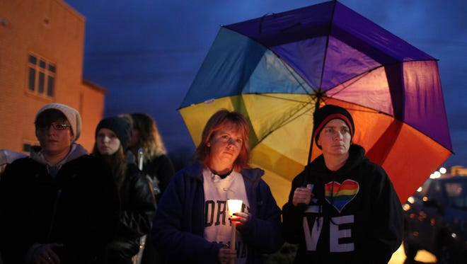 Stacy Manning, left, and Jessica Freeman  attend a candlelight vigil to remember the life of Leelah Alcorn, a 17-year-old transgender girl who committed suicide, in Kings Mills, Ohio.