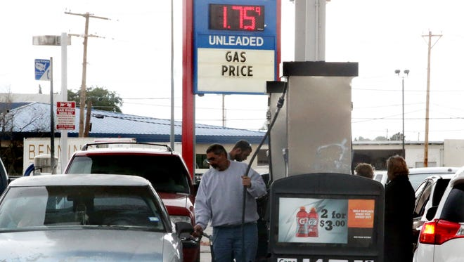 Drivers line up to add fuel to their vehicles at the Fast Trak convenience store Friday at the corner of North Loop and Lomaland drives. The going rate for regular unleaded fuel there was about $1.75.