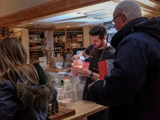 Mike Fair pours a Christmas cocktail for customers
