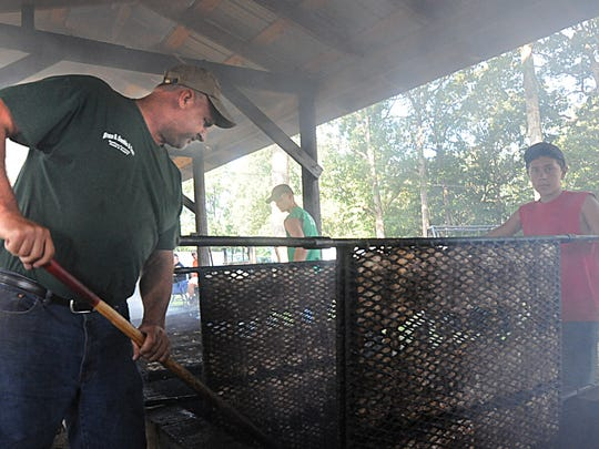 Ben Gamble, left, and Brady Gamble of Bruce B. Gamble & Son Feed & Supply Company help cook about 1,200 chicken halves at the Path Valley Picnic at the Hammond's Grove Fairgrounds in Spring Run on Saturday, August 20 2011.