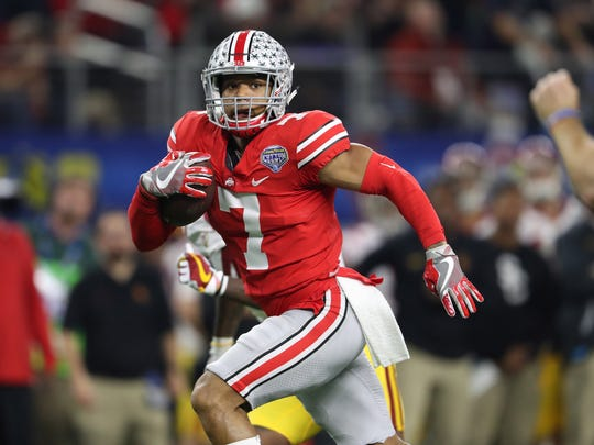 Ohio State safety Damon Webb returns an interception 23 yards for a touchdown in the 24-7 victory over USC.