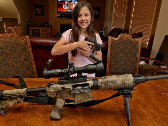 041614dm-kid-guns2