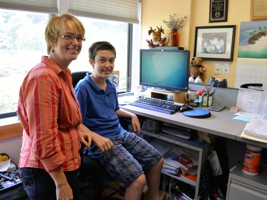 """Gardener's Supply Sales Coach Tammy Bourdeau brings her son, Adam Bourdeau, 12, to work with her after his half-day camp on July 8. Having his mother work for a company that allows her a great deal of flexibility """"makes more time for our family,"""" Adam said."""