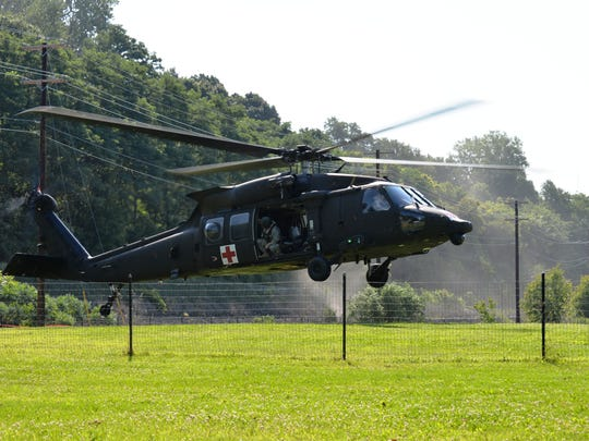 A Vermont National Guard Black Hawk helicopter touches down in a lakefront dog park during training exercises in 2014.
