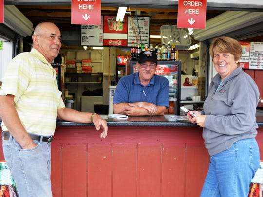 Leo Fortin of Hinesburg (from left), Wes Blair of Huntington, and Mary Fortin of Hinesburg, chat before the fair opens at the Burlington Elks Club food booth.