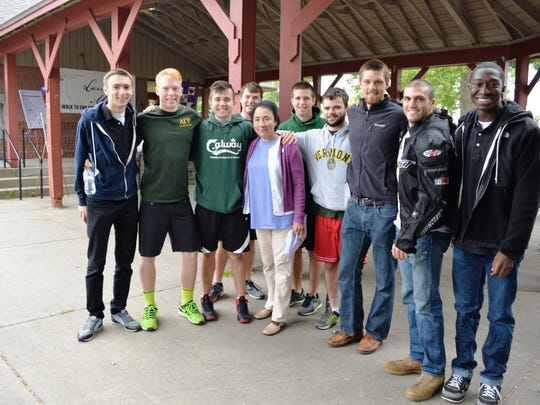 University of Vermont fraternities and One in Four members stand with and show support for JoAnn Winterbottom at Laura's March at Oakledge Park.
