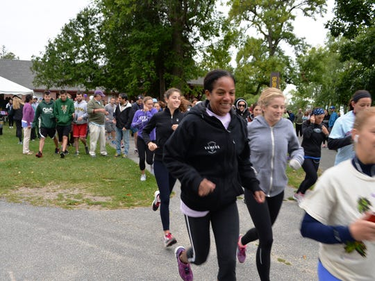 Runner participate in the 5K run during Laura's March.
