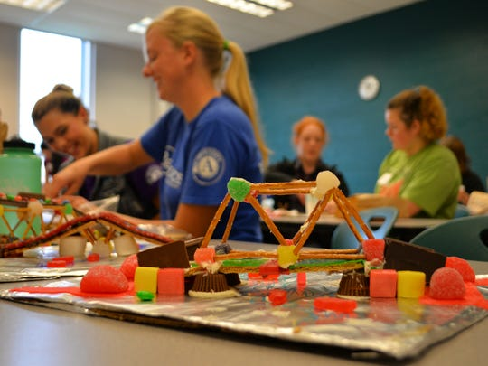 Girls learn about engineering at the In Bridge We Trussed workshop at the 16th Annual Vermont Works for Women Women Can Do conference at Vermont Technical College in Randolph Center on Thursday.