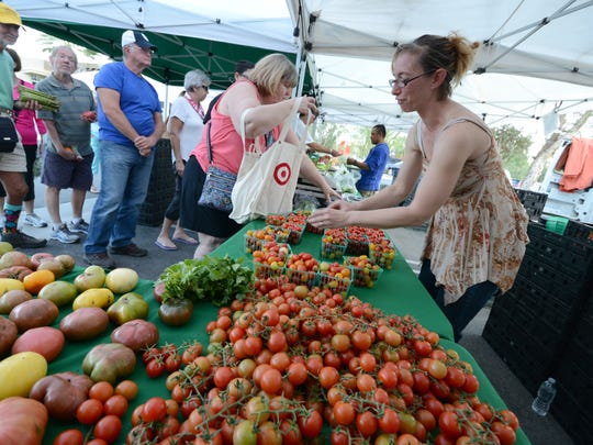 Tisha Julian works for Nest Farms of Anza, which sells fresh produce at the new evening market in Palm Desert.