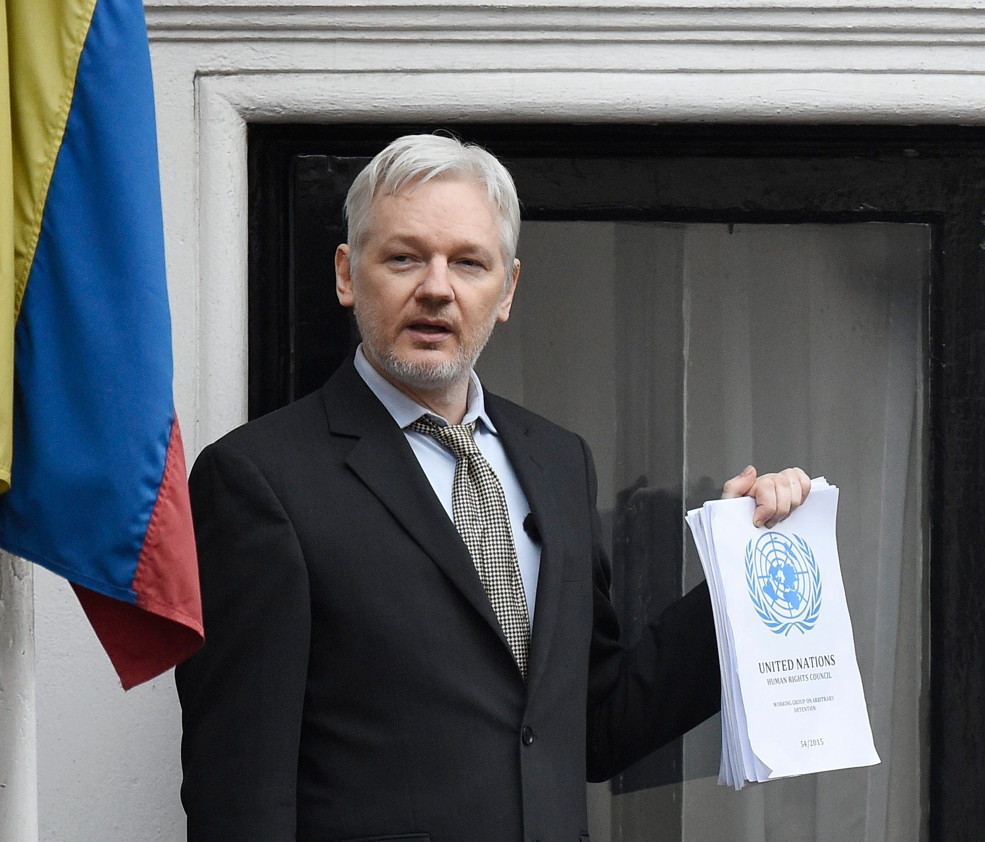 Julian Assange speaks to the media from a balcony of the Ecuadorian Embassy in London, Britain, Feb. 5, 2016.