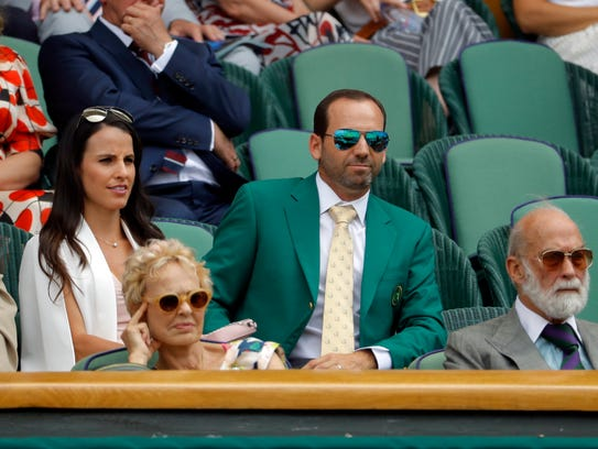Sergio Garcia, wearing his green Masters jacket, and