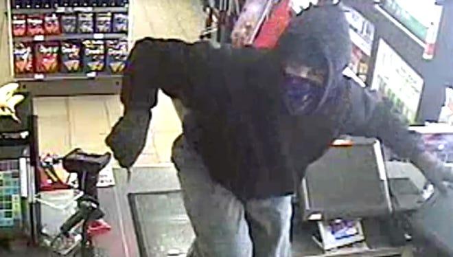 Surveillance photo of robbery suspect.