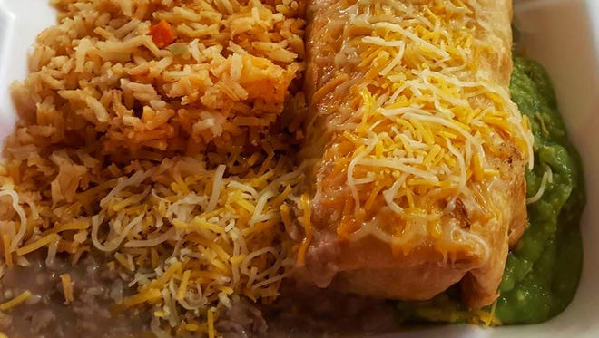 Chimichanga plate ($7.75) includes a chimichanga stuffed with choice of meat, onions and green and red bell peppers, along with a side of beans, rice and guacamole.