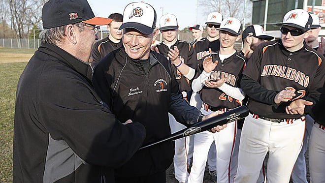 Middleboro's Athletic Director Mike Perry presents a bat to coach Bill Lawrence after winning his 300th game on Monday, April 3, 2017.