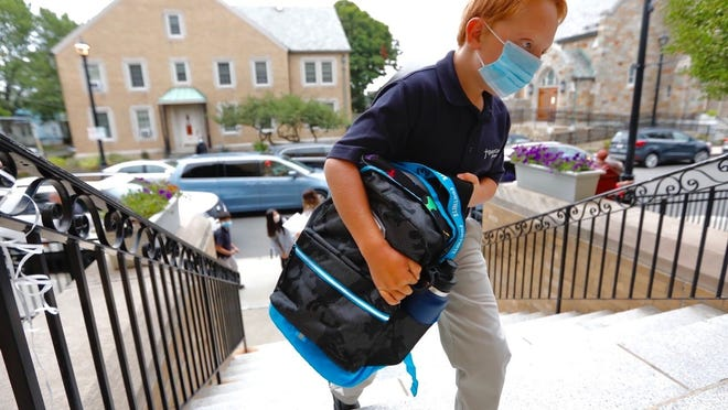 Students were welcomed back to class on the first day of school at Quincy Catholic Academy on Wednesday, Sept. 2, 2020. Greg Derr/The Patriot Ledger