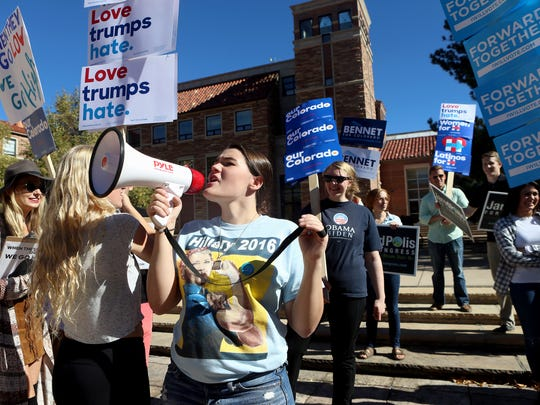 Students hold signs during a Democratic rally on Oct. 27, 2016, at the University of Colorado-Boulder in Boulder, Colorado.