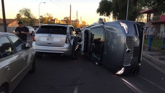 Scene from an accident in Tempe. The car on its side is an Uber self-driving car.