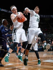 Michigan State's Tori Jankoska, left, comes down with