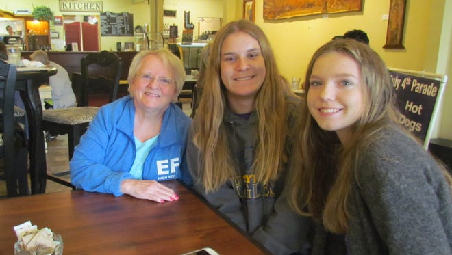 EF High School Exchange coordinator Linda Rau of Mill City, left, and foreign exchange students Franziska Klünder of Borgfeld/Bremen, Germany, center, and Clara Pedersen of Lyngby, Denmark stop by the Canyon Conversations at Moxieberry to talk about their experiences attending Stayton High School this past school year.