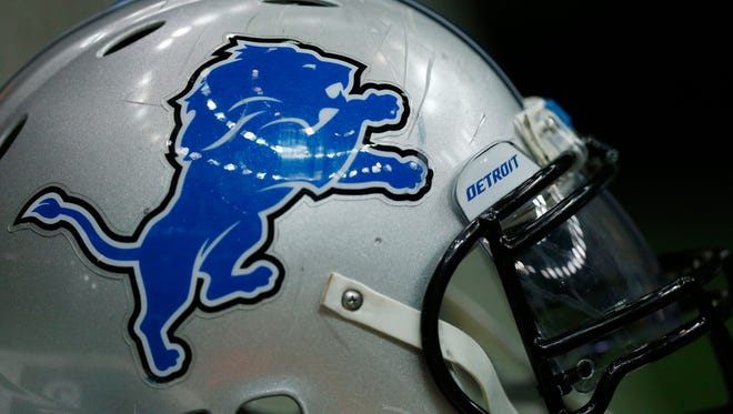 A Detroit Lions helmet sits on the field before an NFL football game against the New Orleans Saints in New Orleans, Monday, Dec. 21, 2015.