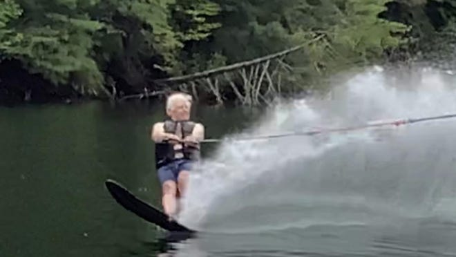 To boost his spirits after his house burned last spring, Charlie Ellis went water skiing on Lake Seed in north Georgia.
