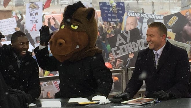 "ESPN ""College GameDay"" anchor Lee Corso, center, puts on a Broncos head after picking Western Michigan to win."