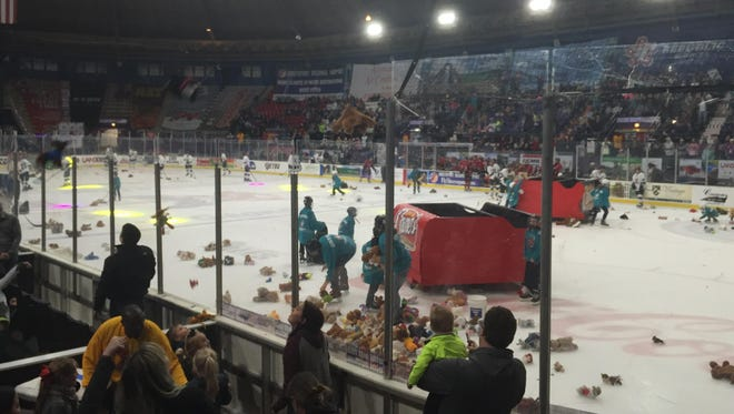 Stuffed animals littered the ice during the Teddy Bear Toss at George's Pond on Saturday.