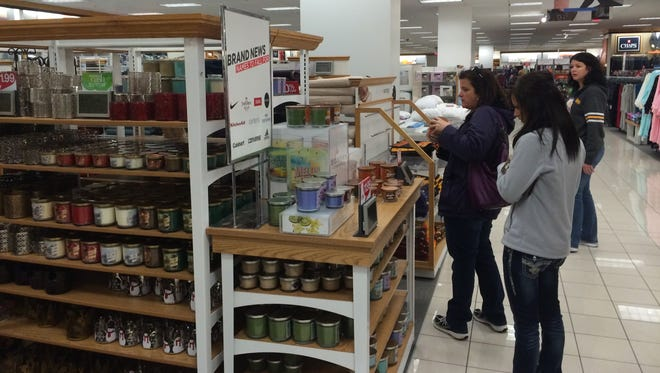 Customers check out the expansive collection of candles at Kohl's in Plover.