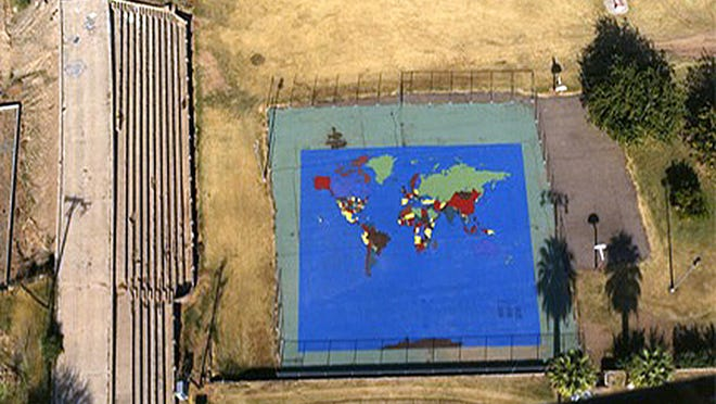 "The world as seen from ""space"" above Tempe Beach Park was created in 1988 by McClintock High School students. The 8,272-square foot map earned a place in the Guinness Book of Records. The stone baseball field bleachers are seen at left."