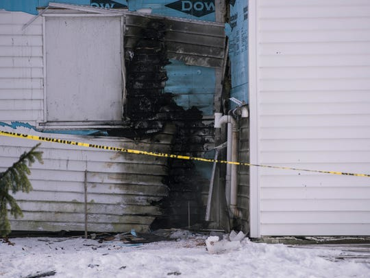 Authorities are investigating the scene of a fire at