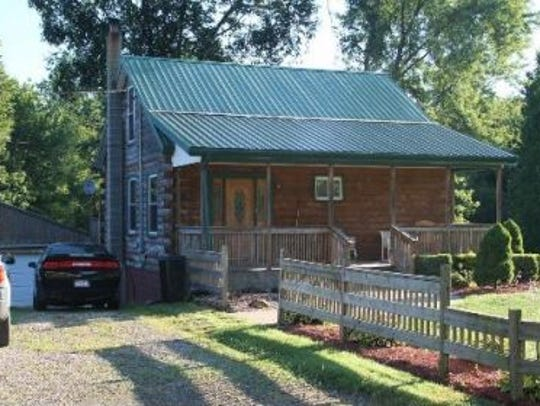 This file image of a cabin on Linn Road shows the structure